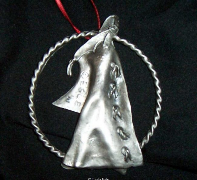 "Chaps - Western Christmas Ornament Linda Egle. These Christmas ornaments are of the western flavor. The images are all worked over a 3 1/4"" rope circle and cast in pewter."
