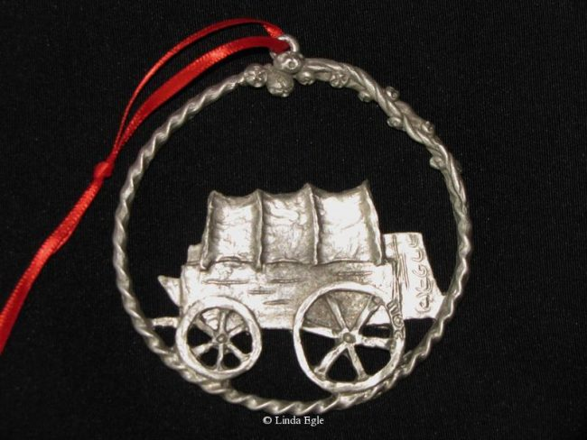 "Chuck-Wagon - Western Christmas Ornament Linda Egle. These Christmas ornaments are of the western flavor. The images are all worked over a 3 1/4"" rope circle and cast in pewter."