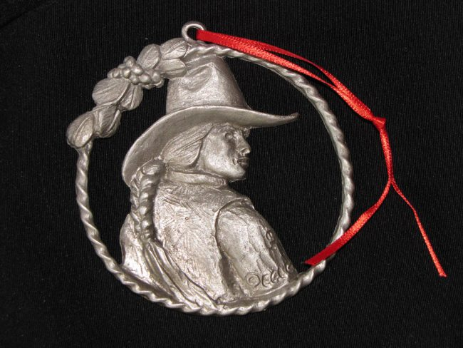 "Cowgirl - Western Christmas Ornament Linda Egle. These Christmas ornaments are of the western flavor. The images are all worked over a 3 1/4"" rope circle and cast in pewter."