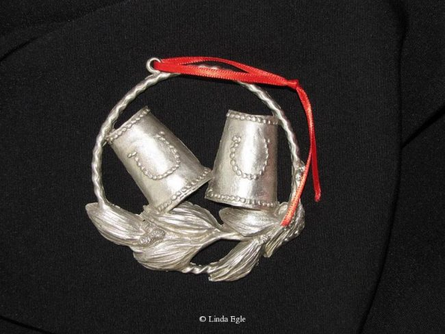 "Leather-Cuffs - Western Christmas Ornament Linda Egle. These Christmas ornaments are of the western flavor. The images are all worked over a 3 1/4"" rope circle and cast in pewter."