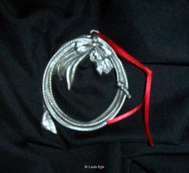 "Rope - Western Christmas Ornament Linda Egle. These Christmas ornaments are of the western flavor. The images are all worked over a 3 1/4"" rope circle and cast in pewter."