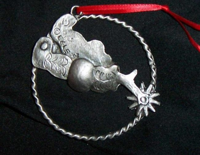 "Spur - Western Christmas Ornament Linda Egle. These Christmas ornaments are of the western flavor. The images are all worked over a 3 1/4"" rope circle and cast in pewter."