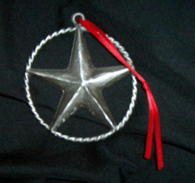 "Star - Western Christmas Ornament Linda Egle. These Christmas ornaments are of the western flavor. The images are all worked over a 3 1/4"" rope circle and cast in pewter."