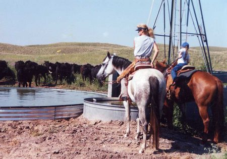 Linda Egle on the ranch with her granddaughter.